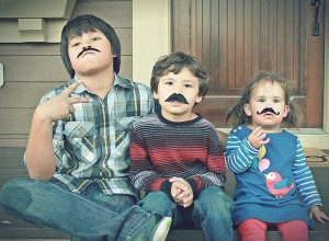 Emmy and her cousins with mustaches