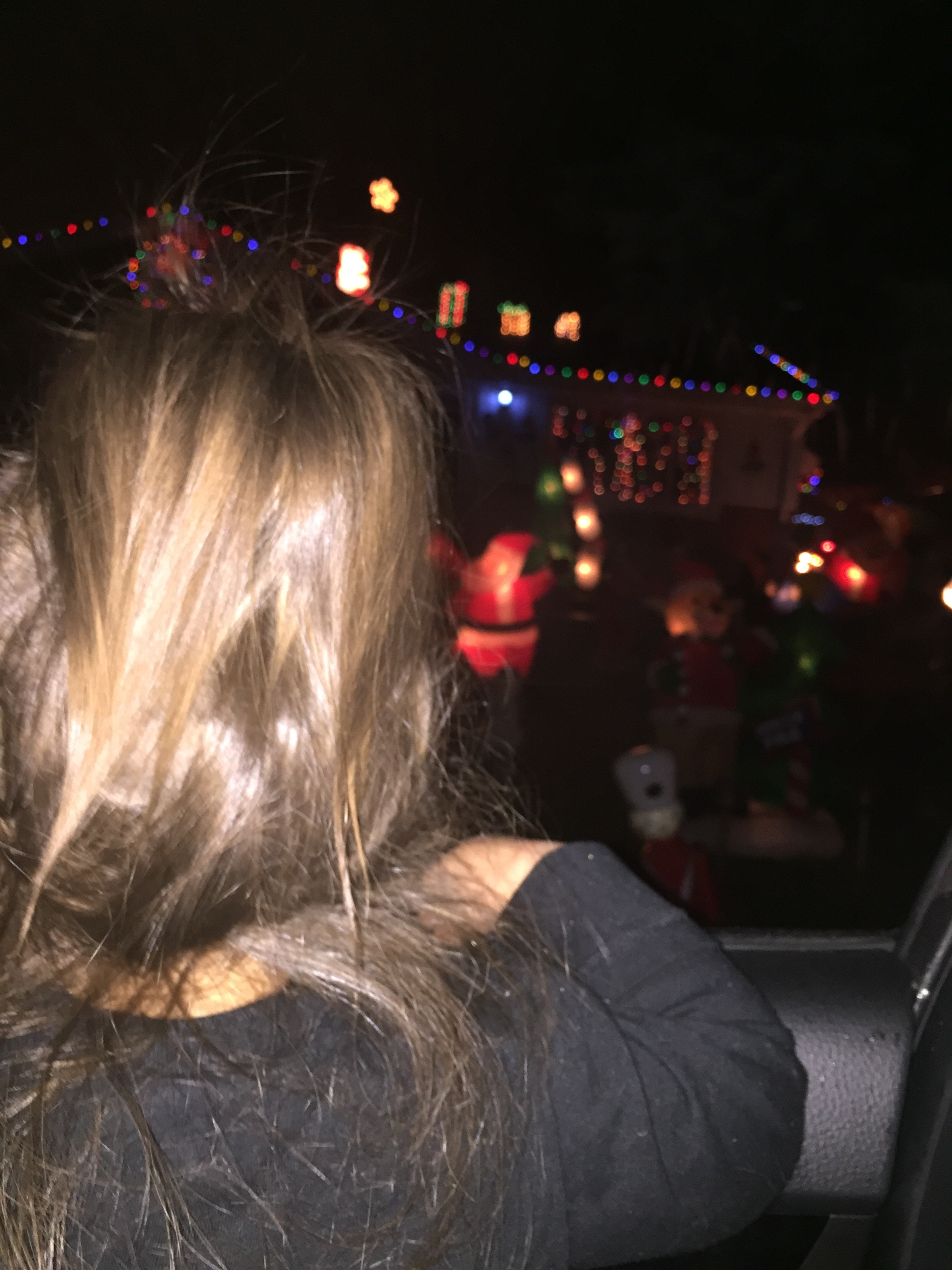 "We went to look at Christmas lights and I let Emmy sit on my lap in the front seat. She was in total awe and kept asking to go to the next party (aka the next house with lights) and said, ""I love parties!!!"" We may have our hands full with this one..."