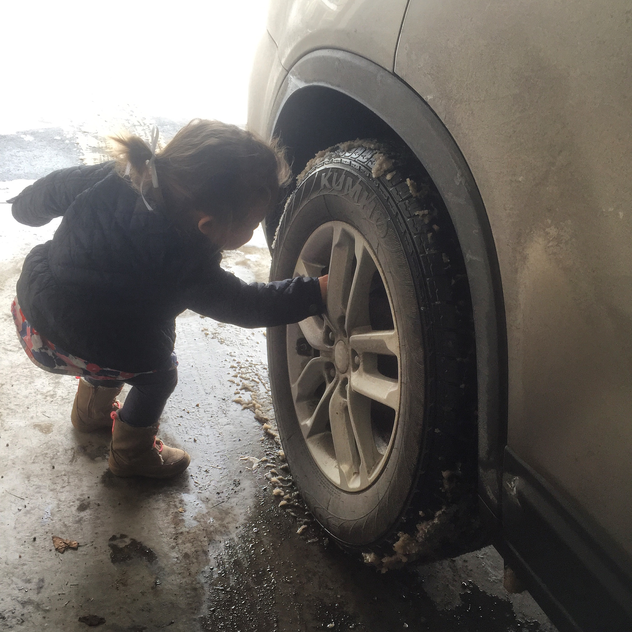 """I'm working, mom! I need to fix this tire with my wrench!"""