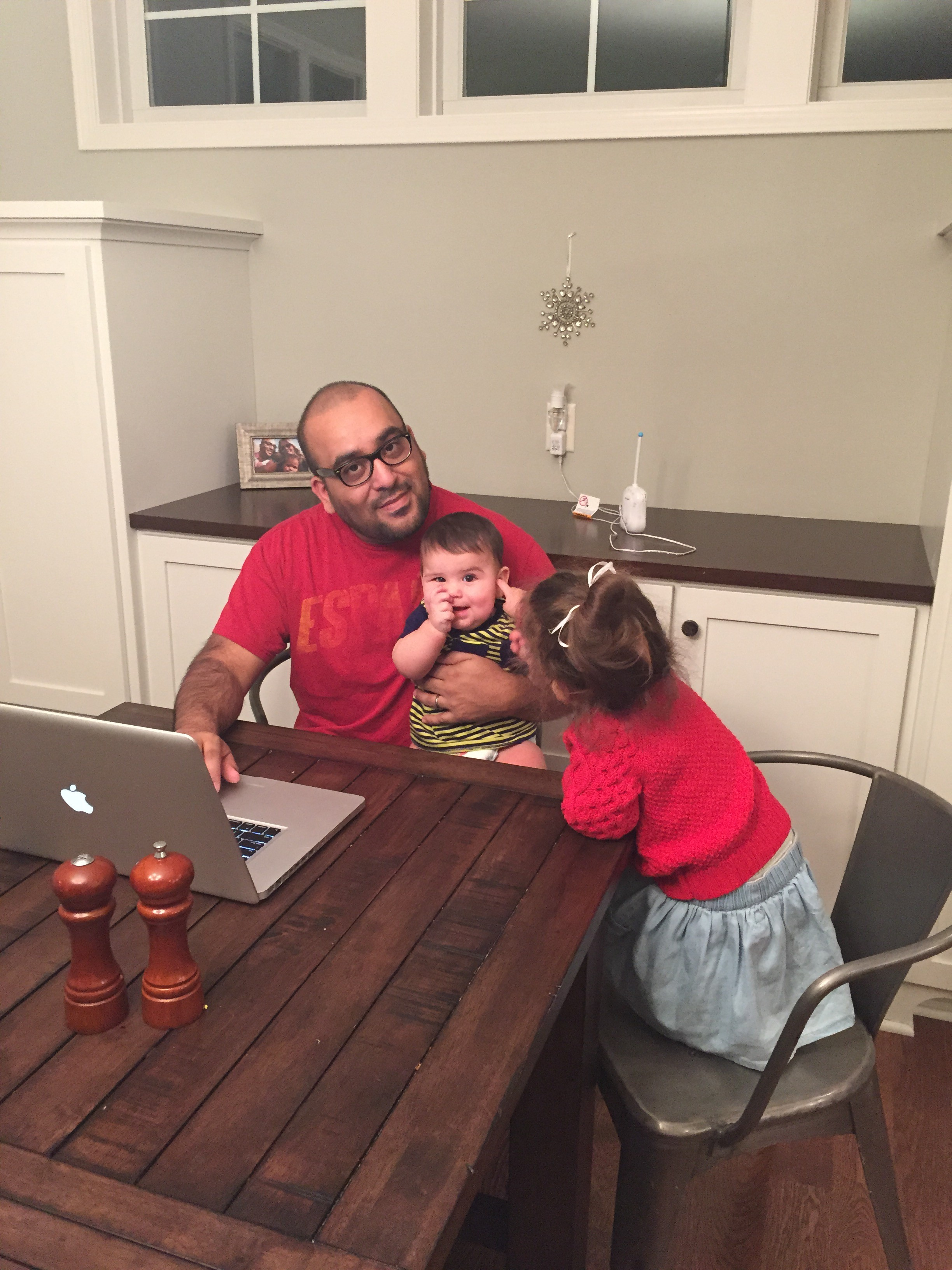 When Jeremiah tries to get a bit of work done at home, this is usually the way it goes...surrounded by kids (and his wife) wanting to talk and play.  And just a heads up, Emmy loves to give wet willies these days...to those who least expect it.